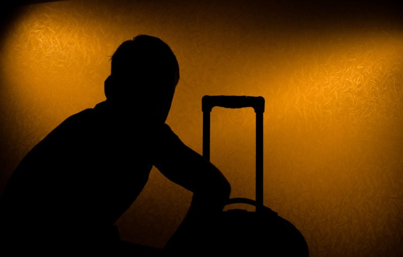 Travel delay - silhouette of man