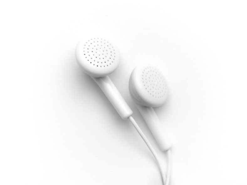 Own It! 157 | Marketing This Podcast - photo shows ear buds